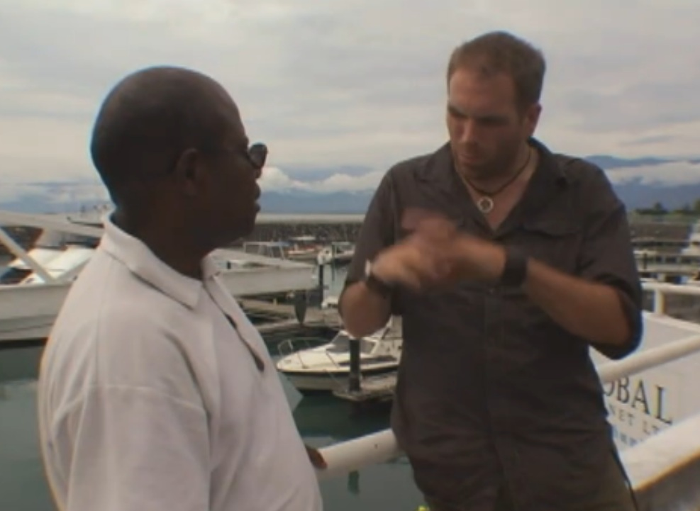 PNG native Jacob Kepas (left) is interviewed by Josh Gates
